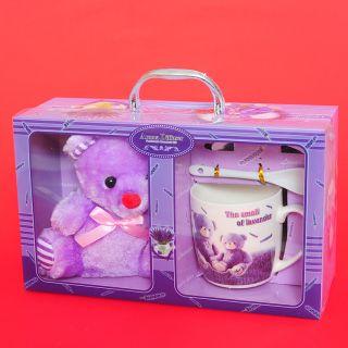 Сувенир ,керамична чаша с плюшена играчка